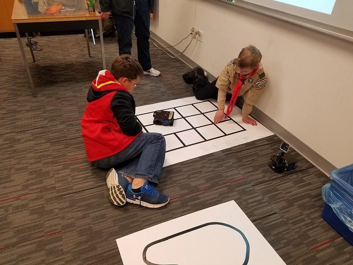 Boy Scouts testing their robots
