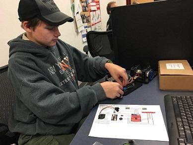 young man building a robot line follower